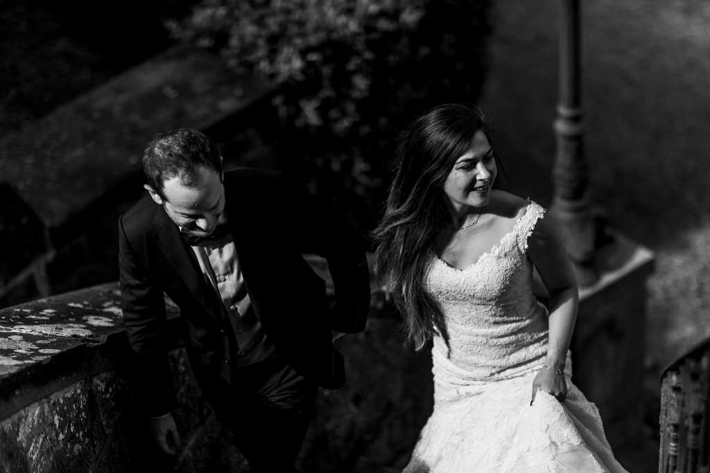 Bride and groom walk up Italian villa stairs during session with Ontario & Destination Wedding Photographer