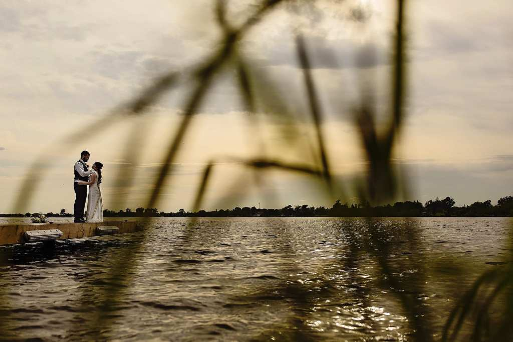 Bride and groom on dock along St Lawrence river
