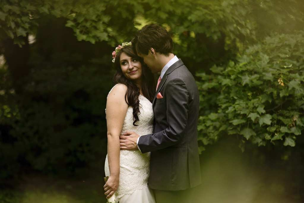 bride and groom cuddle during first look ahead of Strathmere wedding ceremony