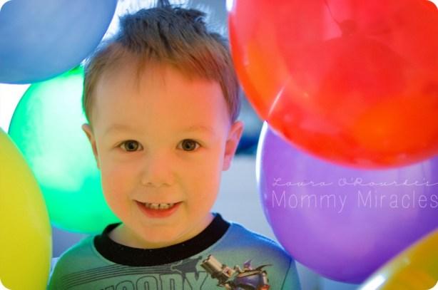 Cameron Through Balloons
