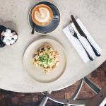 breakfastinthesky with Colombian Eggs and Flat White at table nhellip