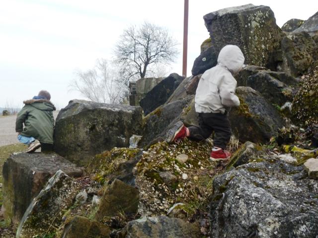 Children playing in rubble at the Birkenkopf Stuttgart, Germany