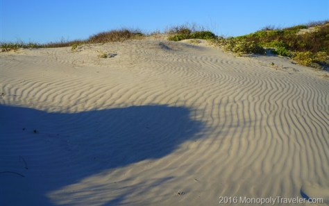 Sandy dunes shaped by ocean breezes