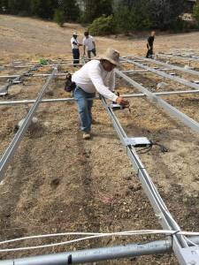 Day Labor member José working on a solar panel installation