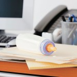 BATXR9 Baby bottle on desk of working mother in office. Image shot 2009. Exact date unknown.