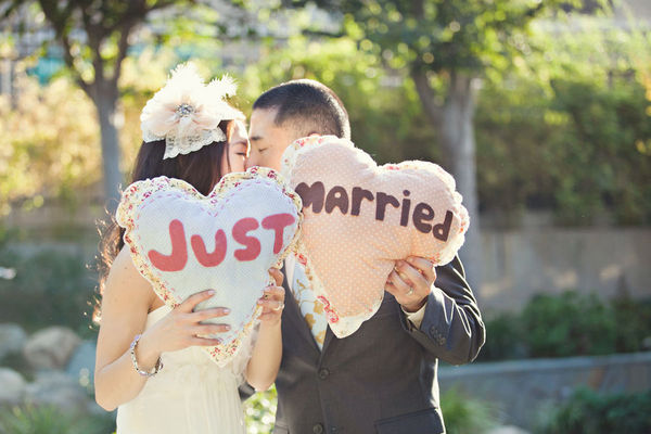 "heart shaped pillows say ""Just Married"""