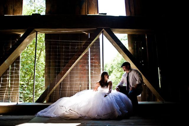 bride and groom in a rusic barn