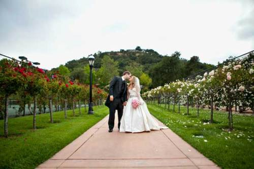 bride and groom in a garden in Malibu