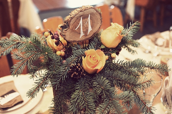 rustic pine. wood, and rose centerpieces