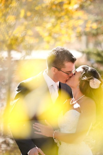 18b-Devils-Thumb-Ranch-wedding-Becky-Young Photography-fall-leaves-kiss