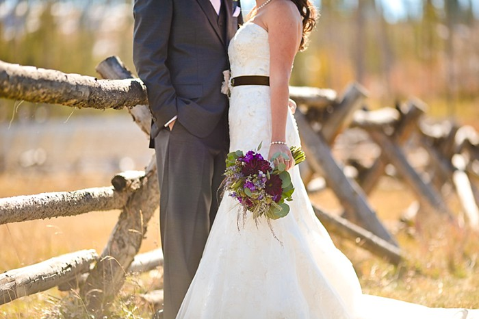 6-Devils-Thumb-Ranch-wedding-Becky-Young Photography-bouquet-by-fence
