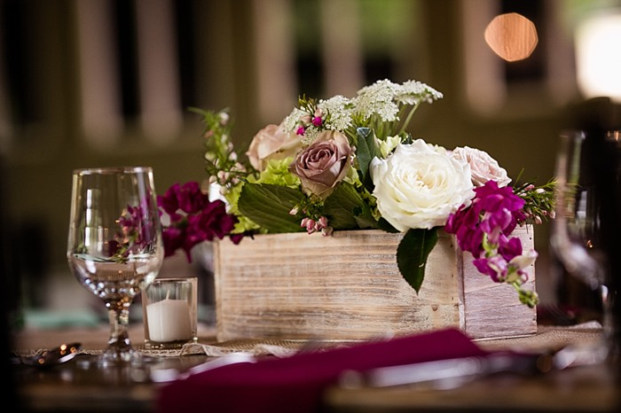rustic wooden centerpiece with white and maroon flowers western North Carolina handmade wedding by Shutter Love Photography
