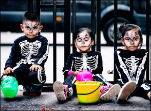 """Children celebrating Dia De Los Muertos in """"Que Caramba Es La Vida"""""""