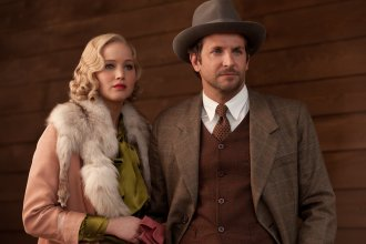 "Jennifer Lawrence and Bradley Cooper in ""Serena."""