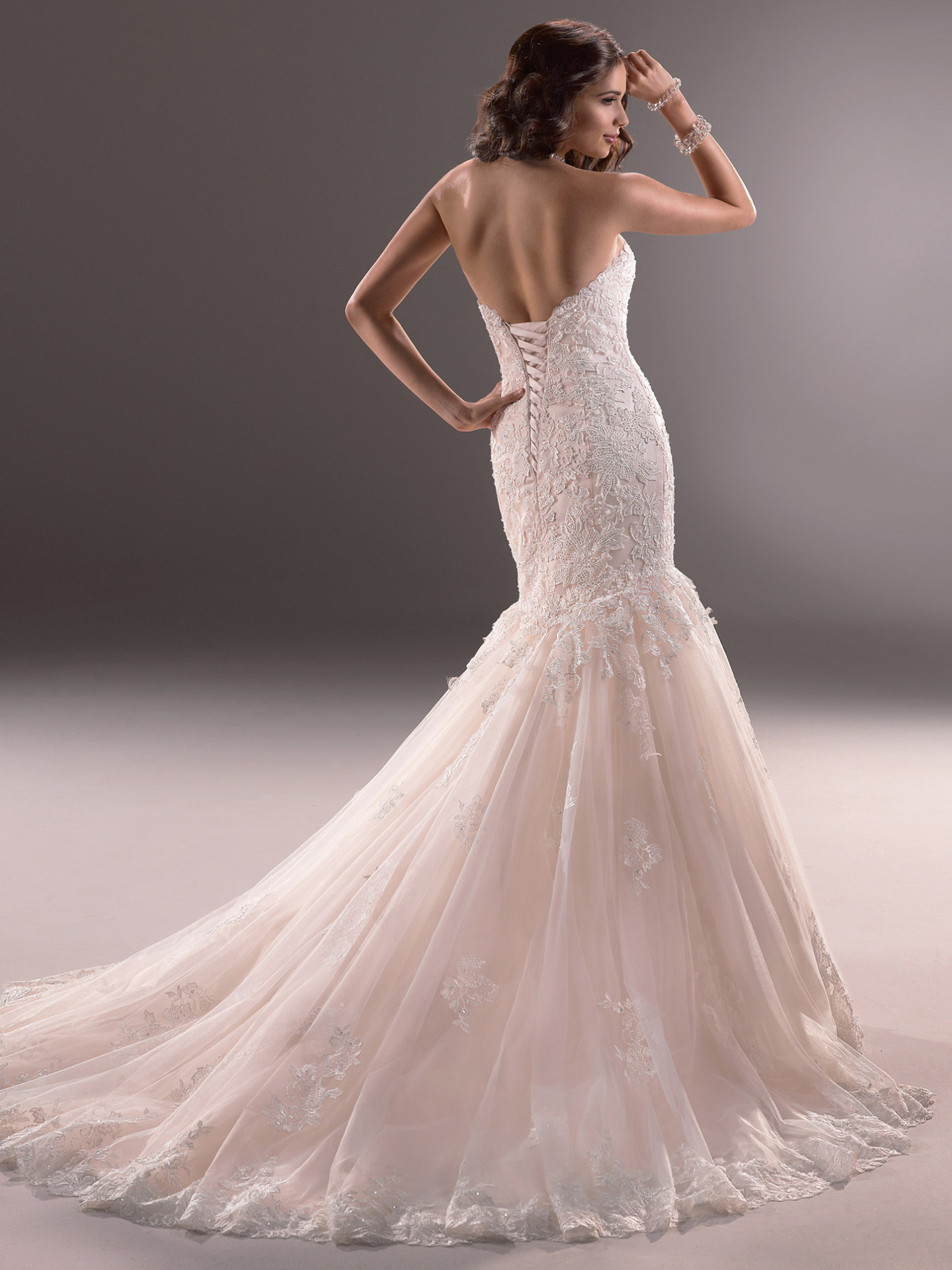 Affordable Marianne Blush Wedding Ly Embellished Lace Adorns Thisdramatic Fit Flare Wedding Gown Even More Blush Wedding Dresses By Maggie Sottero Love Maggie wedding dress Blush Wedding Dress