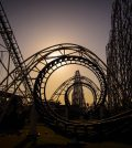 Corkscrew roller coaster at dusk