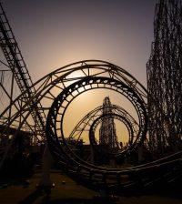 Corkscrew roller coaster at dusk