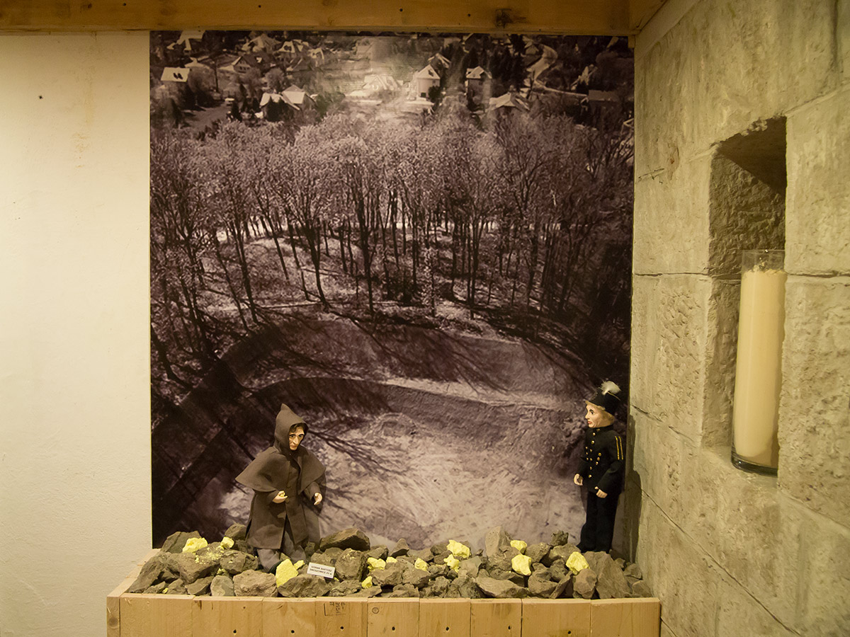 Wizualizacja górników pracujących przy wydobyciu siarki