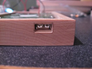 A heads on view of the USB port hole.