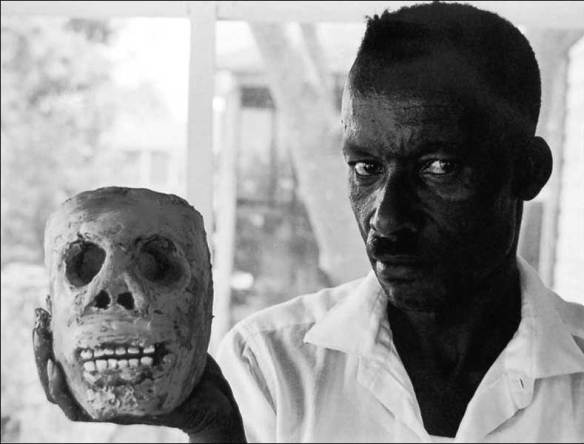 "BluesmanJames ""Son Ford"" Thomas with one of his clay skulls; pic: William Ferris"