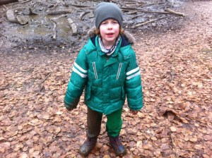 Boy covered in mud