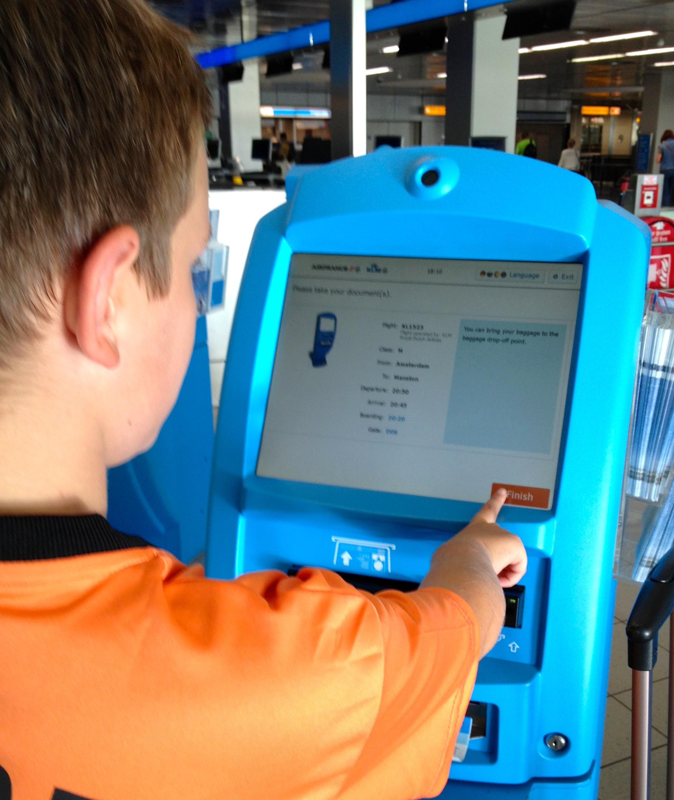 KLM self check-in at Amsterdam. Copyright Gretta Schifano