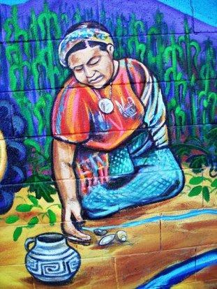 Pintura de la Dra. Rigoberta Menchú Tum en el campo.