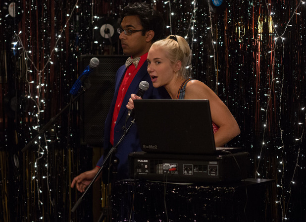 Nancy and Tamwar host a musical bingo night, complete with our signature glimmer curtains! Photo courtesy Digital Spy.