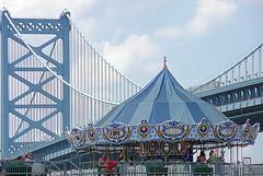 Carousel, shirtless guy, & Ben Franklin Bridge