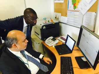Arif (Chief Economist- WFP) and Grégoire (Coordinator- CAID) examine visualizations of DRC data
