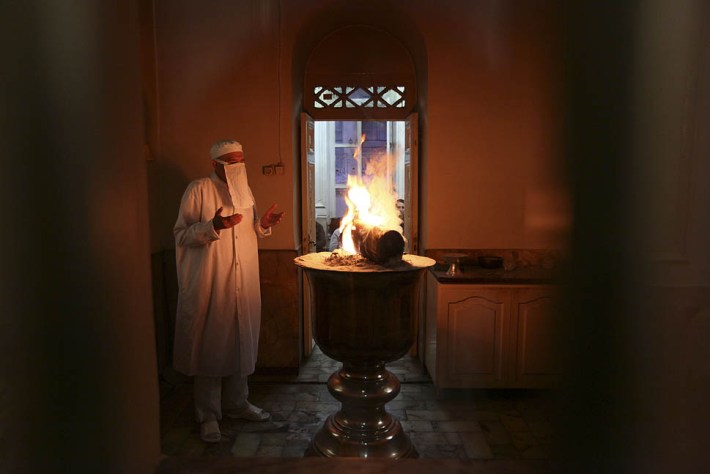 An Iranian Zoroastrian priest, performs a ritual at a fire temple in Tehran, Iran, Monday, Sept. 12, 2011. Zoroastrians are recognized in the Iranian constitution as religious minorities who have their own lawmaker in parliament. Zoroastrianism lost dominance in Iran after Muslim Arabs conquered Persia in the 7th century. (AP Photo)