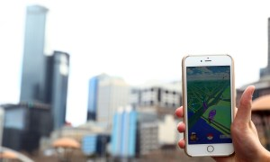 MELBOURNE, AUSTRALIA - JULY 13:  A man holds up his phone as he plays the Pokemon Go game on July 13, 2016 in Melbourne, Australia. The augmented reality app requires players to look for Pokemon in their immediate surroundings with the use of GPS and internet services turning the whole world into a Pokemon region map. The hugely popular app has seen Nintendo shares soar following its limited release in the US, Australia and New Zealand on July 6.  (Photo by Robert Cianflone/Getty Images)