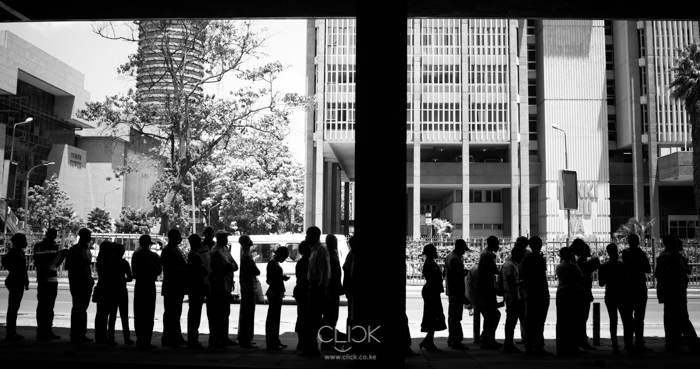 Technical University, 1156hrs. Voters are silhouetted in the shade of City Square Post Office as they wait co cast their votes. Canon 60D. 24mm (EF 24-105mm f/4L IS USM) 1/640sec at f/5.0, ISO 640