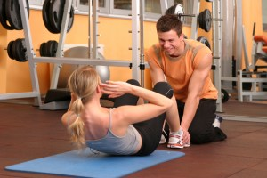 Personal trainer working with client
