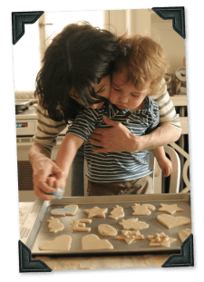 PHOTO: Photo of boy and his mother making cookie cutouts.