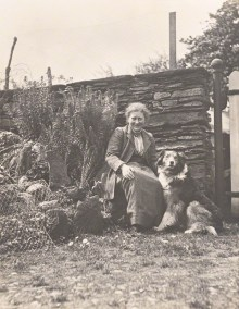 PHOTO: Beatrix Potter (Mrs. Heelis) by Charles King, April/May 1913, with her favourite collie Kep in the garden at Hill Top Farm and wearing her familiar Herdwick tweed skirt and jacket.