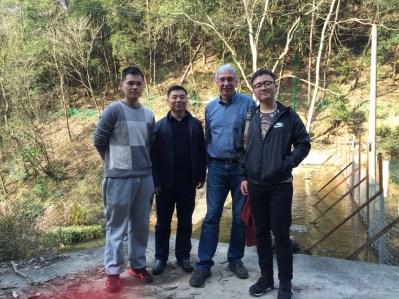 Collaborators tour a study site in China.