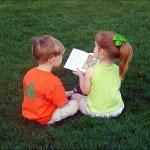 PHOTO: Kids reading outside.