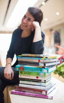 Librarian Leora Siegel with book stack