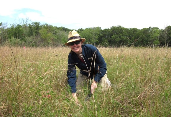 PHOTO: Ksiazek poses for a photo among prairie grasses.