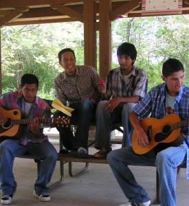 Jesus singing with fellow Green Youth Farm participants for a Talent show.
