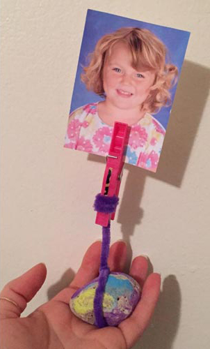 PHOTO: A photo holder made from a painted stone, clothespin, and colorful pipe cleaner.