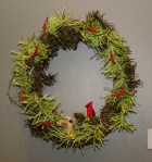 PHOTO: A wreath made entirely of raffia, including the tiny, crocheted raffia birds nesting in it.