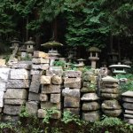 PHOTO: Finished Japanese garden lanterns by Kinzo Nishimura sit with unworked stone in the foreground.