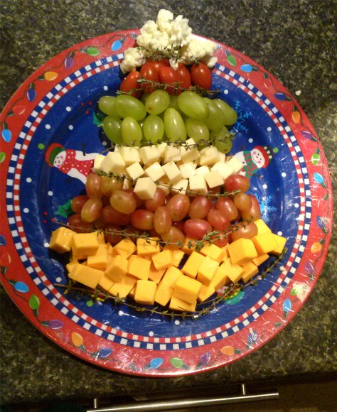 PHOTO: A cheese and fruit plate in a holiday theme is fun for kids to graze.