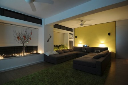 comfy modern brown living room interior design with white recessed lighting plus yellow wall color accent