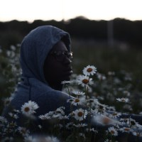 BLACK MAN IN FLOWERS