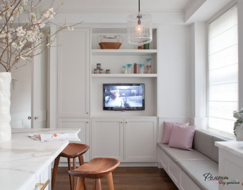 Lovely-white-tv-cabinet-in-the-kitchen-towards-the-dining-and-cooking-area