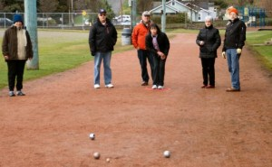 Participants play the game of petanque at Edmonds Civic Center Field.