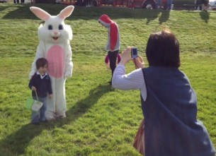 Parents and their kids take advantage of a photo opportunity with the bunny in 2013.